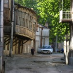 Pre-soviet wooden houses lean over the streets of Tbilisi