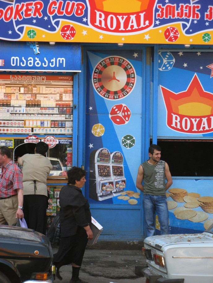 A man stands at the entrance to a dubious establishment near the Tbilisi Central Rail station