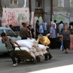 Laborers push flour into the commercial district surrounding the Tbilisi Central Rail station