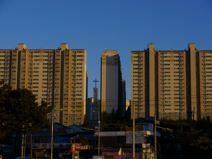 A Church finds its place between the plain apartment blocks of Suwon